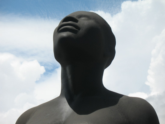 Picture of  The  Redemption Song Monument Female Head Closeup at Emancipation Park, Kingston, Jamaica is shown on this page.