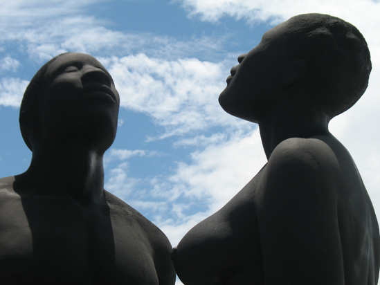 Picture of  The  Redemption Song Monument Heads Closeup at Emancipation Park, Kingston, Jamaica is shown on this page.