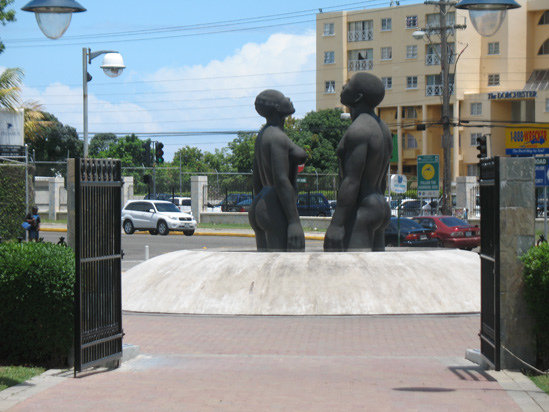 Picture of  The  Redemption Song Monument In Gates at Emancipation Park, Kingston, Jamaica is shown on this page.