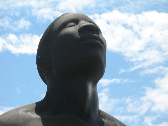 Picture of  The  Redemption Song Monument Male Head Closeup at Emancipation Park, Kingston, Jamaica is shown on this page.