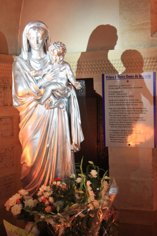Statue Of Mother Mary And Baby Jesus With Shadow Marseille France