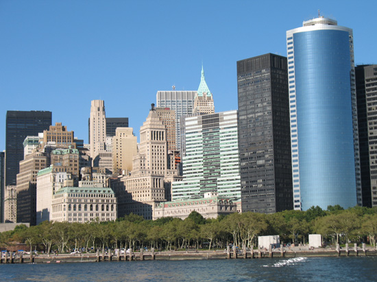 Picture of  The Manhattan Skyline from Statue of Liberty Boat, New York, USA is shown on this page.