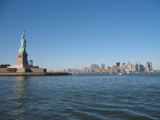 Picture of  The Statue of Liberty and the Manhattan Skyline is shown on this page.