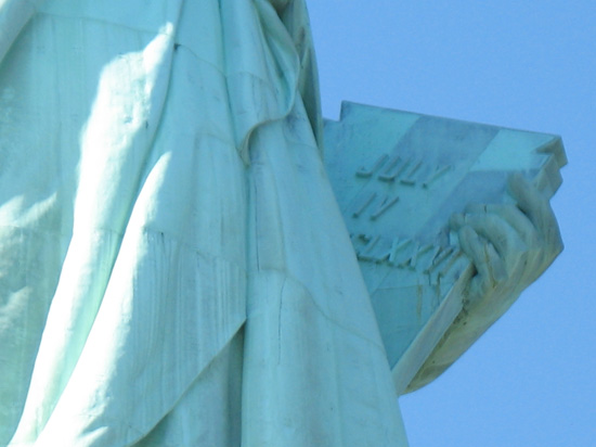 Picture of  The Tablet of The Statue of Liberty is shown on this page.