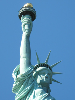Picture of  The Statue of Liberty Torch is shown on this page.