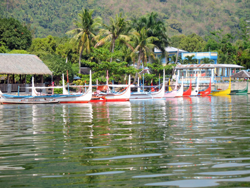 Picture of  The Colourful Catamarans at Lake Taal, The Philippines is shown on this page